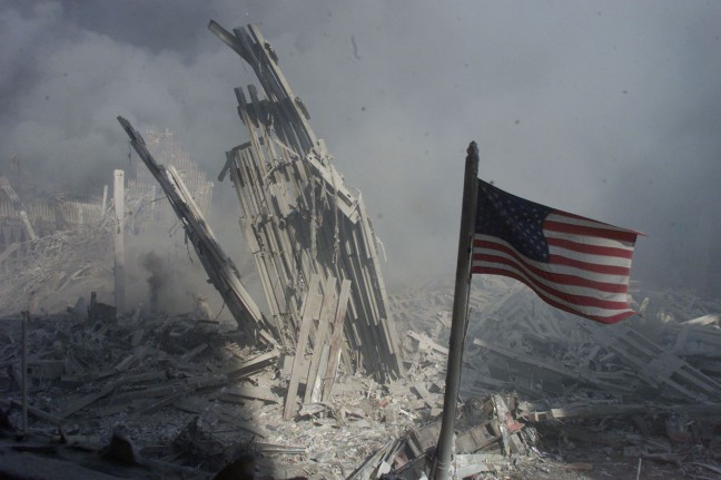 AMERICAN FLAG FLIES AS WORLD TRADE CENTER SMOKE AND DUST LINGERS IN AIR.